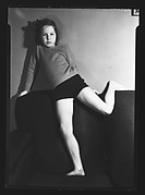[Unidentified Young Girl with Leg Draped Over Sofa]