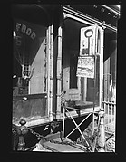 [Shopfront Façade with Painted Locksmith and Blacksmith Signs, No. 8 Stanton Street, New York City]