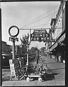 [Sidewalk Scene with Keeble-McDaniel Clothing Company Sign, Main Street, Selma, Alabama]