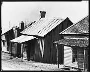 [Row of Wooden Houses, Mississippi]