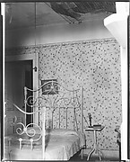 [Bedroom with Hanging Light Fixture, Flower Print Wallpaper, and Decaying Ceiling]