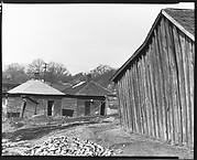 [Wooden Houses with Pile of Bricks in Foreground, Tupelo, Mississippi]