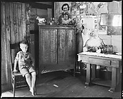 [Barefoot Boy in Chair in Coal Miner's House, Vicinity Morgantown, West Virginia]