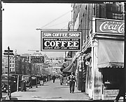 [View Down Canal Street with Coffee Shop Sign, New Orleans, Louisiana]
