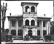 [Converted Italianate Revival House with Wrecking Company Signs on Tower and Workers and Parked Cars, Near Tuscaloosa, Alabama]