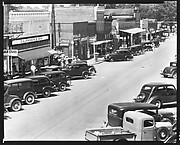 [Parked Cars and Pedestrians on Main Street, From Elevated Position, Greensboro, Alabama]