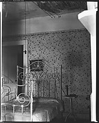 [Bedroom Interior with Hanging Light Fixture, Flower Print Wallpaper, and Decaying Ceiling]
