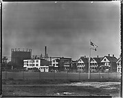[Houses and Oil Refinery Across Baseball Field with Flag in Foreground, Bridgeport, Connecticut]