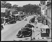 [View of Main Street with Parked Cars, Pedestrians, and Alabama Power Company Sign, Greensboro, Alabama]