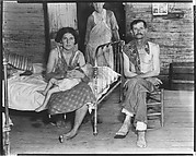 [Bud Fields with His Wife, Her Mother, and Infant Child in Bedroom, Hale County, Alabama]