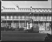 [Phoenix Building with Second Story Grillwork and Parked Flatbed Truck in Front on Water Avenue, Selma, Alabama]