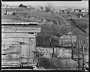 [Wooden Houses with Farm Buildings and Houses on Hillside in Distance, Outskirts of Tupelo, Mississippi]