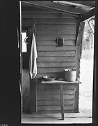 [Washstand with Pail, Bowl, and Mirror in Dog Run of Burroughs Home, Hale County, Alabama]
