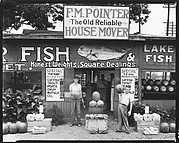 [Roadside Fish and Produce Stand with Young Men Holding Watermelons, Near Birmingham, Alabama]