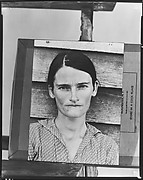"[Copy of Print of ""Alabama Cotton Tenant Farmer Wife"" (Allie Mae Burroughs) on Makeshift Easel]"