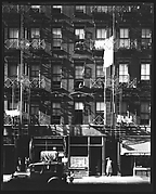 [Tenement Building with Ground Floor Shops and Parked Car on Carmine Street, New York City]