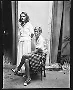 [Two Women in Courtyard, Havana]