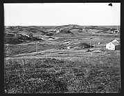 [View of Cape Cod with Junked Automobile and Houses in Distance, Massachusetts]