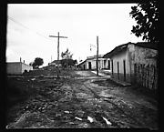 [Houses and Power Lines on Dirt Road, Cuba]