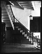 [Entryway Interior with Stairwell, Rocking Chair, and Bookcase, Possibly Havana]