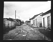 [View Down Dirt Road with Wooden Houses, Havana Outskirts, Cuba]
