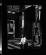 [Flophouse Entrance on the Bowery with Man Seated on Stoop, New York City]