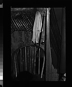 [Walker Evans's Darkroom at 92 Fifth Avenue with Chair, Hat, and Sheet Holders on Rack, New York City]