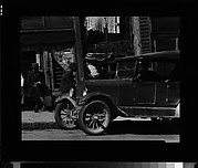 [Street Scene with Parked Car and Men on Sidewalk, Vicksburg, Mississippi]