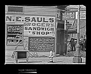 [Painted Advertisements and Menu Boards on Façade of N.E. Saul's Grocery Store, New Orleans, Louisiana]