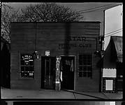 [Shopfront Façades of L. Miles Barber Shop and Star Pressing Club Laundry, Vicksburg, Mississippi]