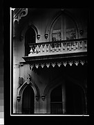 [Pointed-Arch Windows and Balcony Trim of Gothic Revival House]