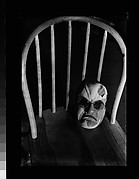 [Japanese Mask with Spectacles on Seat of Chair]