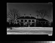 [Brick House with Circular Entry Porch, From Across Lawn]