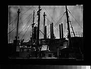 [Port Scene of Ships' Masts, Rigging, and Factory Smokestacks, New York City]