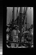 [South Seas: Crew Members at Helm of Cressida]
