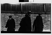 [Men in Hats and Overcoats Standing Against Brick Wall, New York City]