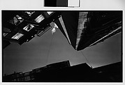 [Architectural Study: View Upwards of Fire Escapes and Balconies at Night, New York City]