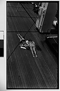[South Seas: Two Women Sunbathing on the Deck of the Cressida, From Above]