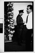 [Policeman in Front of Fruit Stand on Street, Havana]