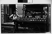 [Fruit Vendor Posing in Front of Cart, Havana]