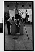 [Man at Communal Laundry in Courtyard, Havana]