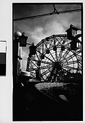 """[""""Wonder Wheel"""" and """"Virginia Reel"""" Rides with Hanging Lamps and Cables, Coney Island, New York]"""