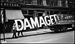 "[Workers Loading Neon ""Damaged"" Sign into Truck, West Eleventh Street, New York City]"