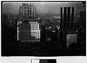 [High-Rise Building Under Construction and Smokestacks, New York City]