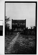 [Dilapidated Wooden House in Barren Field, Southeastern U.S.]