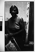 [Woman with Newspaper Seated in Courtyard, Havana]