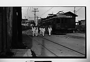 [Sailors Walking on Trolley Tracks Near Depot, Casablanca District, Havana, Cuba]