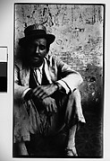 [Man Wearing Boater Seated on Ground, Havana]