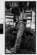 [Man Asleep in Chair in Public Park, Havana]
