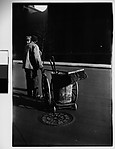 [Two Men and Street Cleaning Pushcart on Street, New York City]